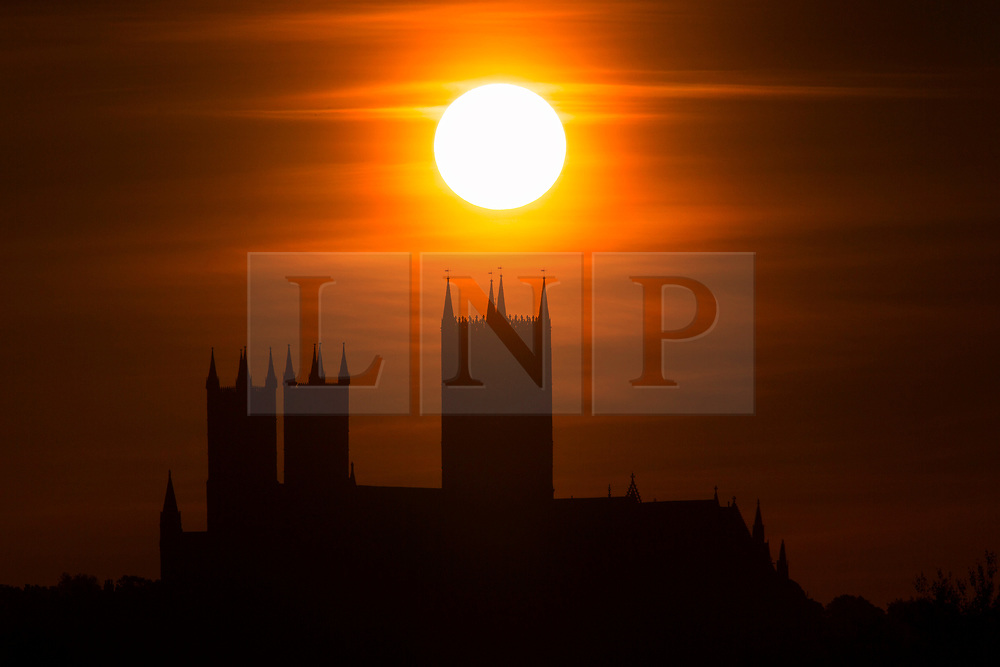 © Licensed to London News Pictures. 29/05/2020. Lincoln UK. The sun rises over Lincoln Cathedral in Lincolnshire this morning as the UK looks forward to a weekend of good weather. Photo credit: Andrew McCaren/LNP