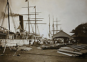 Ship docked at Papeete harbour, photograph by an unknown photographer, early 20th century, <br /> in the MTI-TFM Collection (fonds de la Polynesie Francaise), in the Musee de Tahiti et des Iles, or Te Fare Manaha, at Punaauia, on the island of Tahiti, in the Windward Islands, Society Islands, French Polynesia. The Museum of Tahiti and the Islands was opened in 1974 and displays collections of nature and anthropology, habitations and artefacts, social and religious life and the history of French Polynesia. Picture by Manuel Cohen