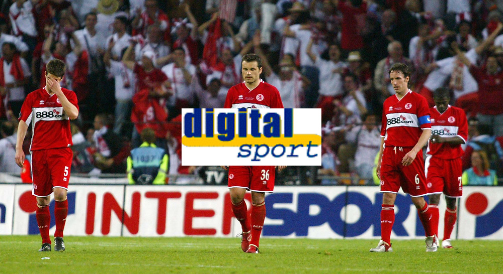 Photo: Chris Ratcliffe.<br /> Middlesbrough v Sevilla. UEFA Cup Final. 10/05/2006.<br /> Boro's players are dejected at the end.