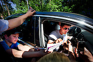 HOENDERLOO - Dutch international Klaas Jan Huntelaar gives his signature to fans when he arrives for the dutch trainingcamp of the Netherlands kicks the ball during a soccer training session in Hoederloo. AFP ROBIN UTRECHT