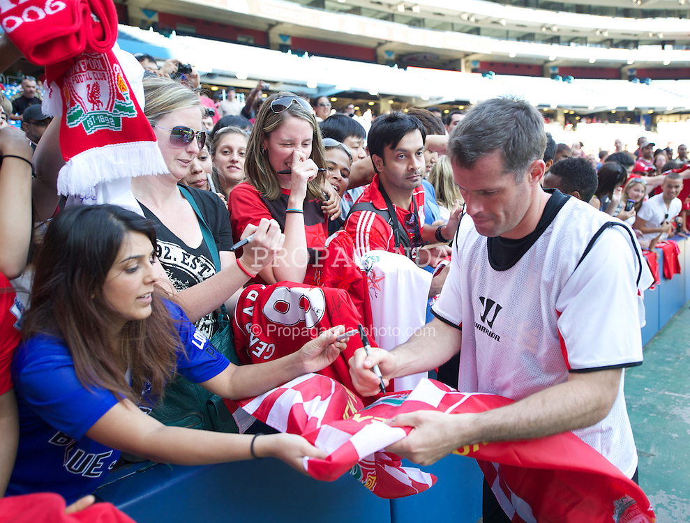 TORONTO, CANADA - Friday, July 20, 2012: Liverpool's Daniel Pacheco signs autographs for supporters after a training session ahead of the side's first match of their North American pre-season tour against Toronto FC at the Rogers Centre. (Pic by David Rawcliffe/Propaganda)