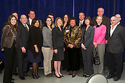 Employees of Armstrong pose for a photo with keynote speaker, Ron Insana of CNBC at the Annual Meeting of the Regional Chamber in Boardman, OH on March, 24, 2011