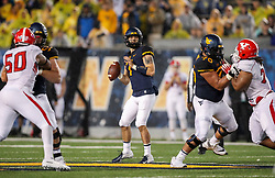 Sep 8, 2018; Morgantown, WV, USA; West Virginia Mountaineers quarterback Will Grier (7) drops back to pass during the third quarter against the Youngstown State Penguins at Mountaineer Field at Milan Puskar Stadium. Mandatory Credit: Ben Queen-USA TODAY Sports