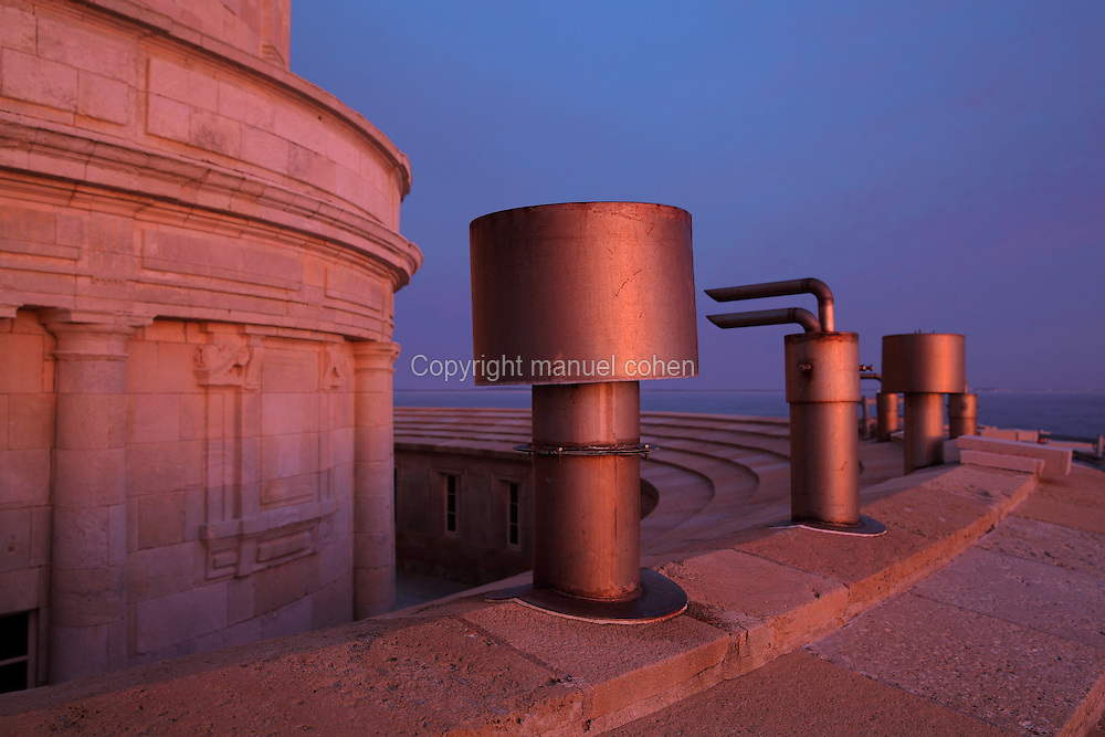 Chimneys from the machines in the buildings encircling the Phare de Cordouan or Cordouan Lighthouse at night, built 1584-1611 in Renaissance style by Louis de Foix, 1530-1604, French architect, located 7km at sea, near the mouth of the Gironde estuary, Aquitaine, France. This is the oldest lighthouse in France. There are 4 storeys, with keeper apartments and an entrance hall, King's apartments, chapel, secondary lantern and the lantern at the top at 68m. Parabolic lamps and lenses were added in the 18th and 19th centuries. The lighthouse is listed as a historic monument. Picture by Manuel Cohen