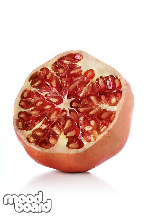 Pomegranate on white bacground - close-up