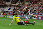 Toumani Diagouraga tackles George Friend during the Sky Bet Championship Play Off Second Leg match between Middlesbrough and Brentford at the Riverside Stadium, Middlesbrough, England on 15 May 2015. Photo by Simon Davies.