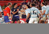 Rugby World Cup, France v Argentina, 19 October 2007. Referee Paul Honnis of New Zealand stops a fight during his record breaking 44th test match to become the worlds most capped referee at the Parc des Princes, Paris, France. Friday 19 October 2007. Photo: Ron Gaunt/Sportzpics.net