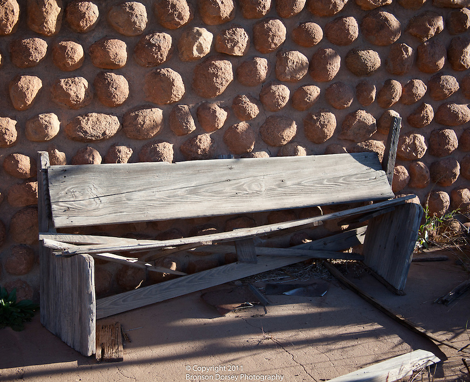 Weathered bench sits outside the H. H. Cole Building in Medicine Mound, Texas.