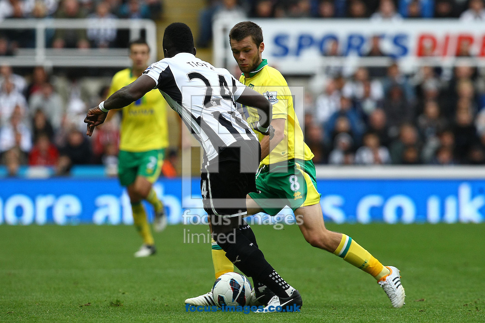 Picture by Paul Chesterton/Focus Images Ltd +44 7904 640267.23/09/2012.Jonny Howson of Norwich and Cheick Tioté of Newcastle in action during the Barclays Premier League match at the Sports Direct Arena, Newcastle.