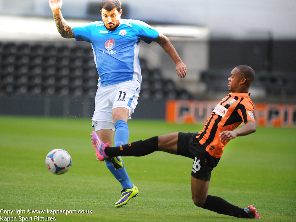 Barnets Mauro Vilhete, holds of Eastleighs Craig McAllister, Barnet v Eastleigh, Vanarama Conference, Saturday 4th October 2014