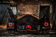 EXCLUSIVE FEATURE:<br /> <br /> The Batmobile has made a come back. Game Over Cycles, a shop that specialises in customising motorbikes have created the Batmobile, an inspired trike from the Tim Burton films, Batman and Batman Returns.<br />  <br /> The original owner of the bike was a client of Game Over Cycles and had been a Batman enthusiast since his childhood. It was bought into the shop in 2014 in a raw state, but their crew made it fully operational and created its present look.<br />  <br /> The bike definitely receives its fair share of attention!<br />  <br /> The bike is still in our workshop, so when we ride it, we get a lot of attention when the Batmobile is driven around. People stop walking and look at it, take photos, point at it. To be honest sometimes it gets so intense, that it actually hard to ride it. For example, when we stop and are at a gas station, people come to talk, ask, look at it from all angles, take photos, record videos says Chris from Game Over Cycles.<br />  <br /> The bike is fully black, featuring bats wings, a replica jet engine exhaust and even a passenger seat!<br /> ©Exclusivepix Media