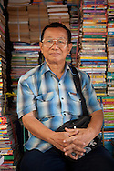 A man selling second hand books at Chatuchak JJ market in Bangkok, Thailand