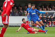 Accrington Stanley defender Seamus Conneely (28) tackling AFC Wimbledon defender Toby Sibbick (20) during the EFL Sky Bet League 1 match between AFC Wimbledon and Accrington Stanley at the Cherry Red Records Stadium, Kingston, England on 6 April 2019.