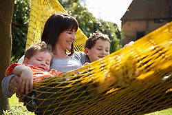 Woman and Children on Hammock