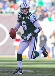 Dec 24, 2011; East Rutherford, NJ, USA; New York Jets quarterback Mark Sanchez (6) runs with the ball during the first half of their game against the New York Giants at MetLife Stadium.