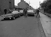 Scene Of Garda Shooting In North Strand.  (N78)..1981..26.05.1981..05.26.1981..26th May 1981..After a shootout in North Strand, Dublin, a Special Task Force Detective was shot and wounded. Word from The Richmond Hospital was that the detective was lucky to be alive as the bullet had narrowly missed a vital artery. He is said to be recovering after surgery...Garda technical officers are seen arriving at the scene of the shooting in North Strand.
