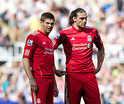 NEWCASTLE-UPON-TYNE, ENGLAND - Sunday, April 1, 2012: Liverpool's captain Steven Gerrard MBE and Andy Carroll look dejected during the Premiership match against Newcastle United at St James' Park. (Pic by Vegard Grott/Propaganda)