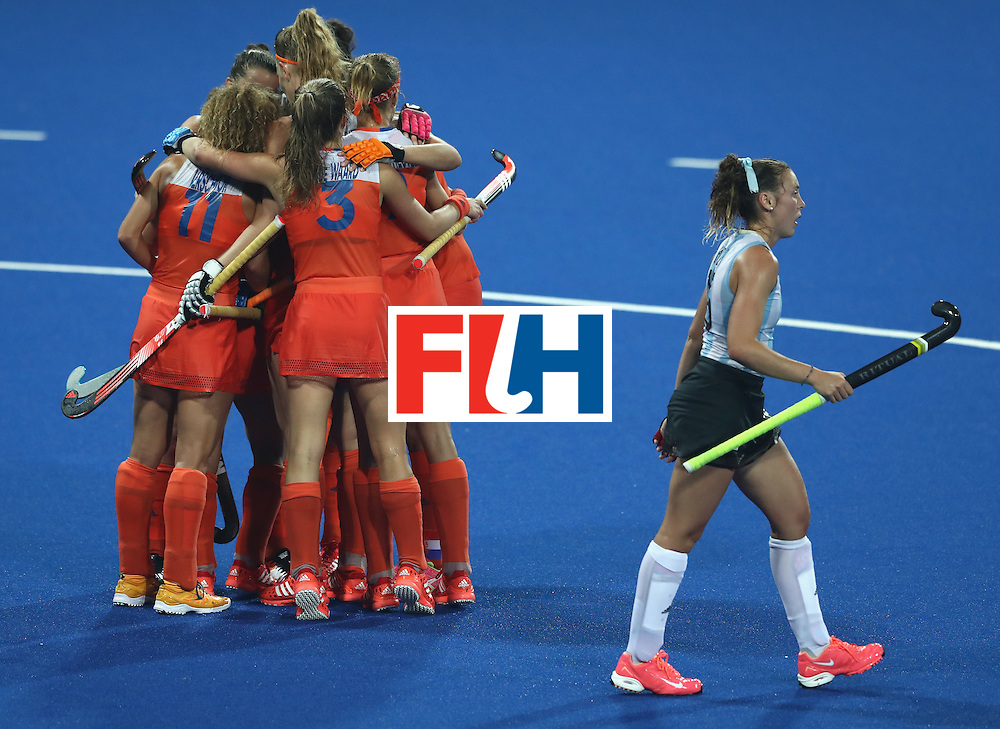 RIO DE JANEIRO, BRAZIL - AUGUST 15:  Kelly Jonker of the Netherlands celebrates with team mates after scoring their third goal during the Women's quarter final hockey match between the Netherlands and Argentina on Day10 of the Rio 2016 Olympic Games held at the Olympic Hockey Centre on August 15, 2016 in Rio de Janeiro, Brazil.  (Photo by David Rogers/Getty Images)