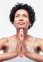 An African American woman during a meditation / yoga session at Club Zum, Seattle, Washington, USA.