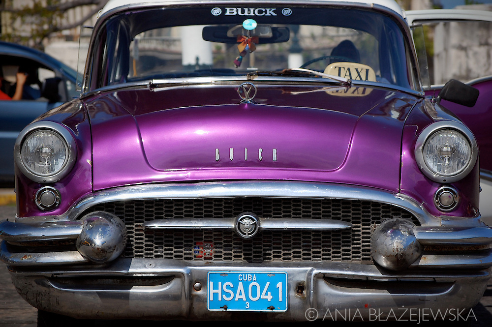 Cuba, Havana. Antique  purple car on the street.