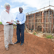 CAPTION: 80% of construction in Malawi is done with bricks; the traditional method for baking these is highly energy inefficent, and it routinely results in bricks that are out of standard with respect to size, shape, strength and quality. The Eco-Bricks vertical shaft brick kiln is designed to change this, and will help to meet a massive demand for quality bricks destined for slum upgradation and sanitation projects. LOCATION: Eco-Bricks (Mthyoka), Lilongwe, Malawi. INDIVIDUAL(S) PHOTOGRAPHED: Peter Schramm (left) and John C Msenda (right).