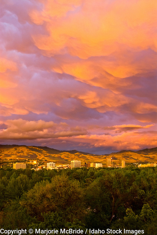 Sunset over downtown Boise and Ann Morrison Park on a cloudy spring evening, Idaho.