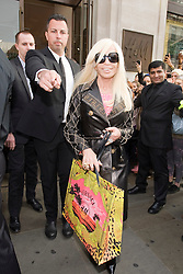 © London News Pictures. 17/11/2011. London, UK. Donatella Versace leaving the Launch of the new Versace collection at H&M on Regent Street, London today (17/11/2011). Shoppers had queued for nearly 24 hours to be first in line for Versace's hotly anticipated collection : Ben Cawthra/LNP