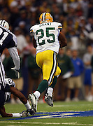 IRVING, TX - NOVEMBER 29: Running back Ryan Grant #25 of the Green Bay Packers breaks away for a 62 yard first quarter touchdown run that narrows the Cowboys lead to 13-10 during the game against the Dallas Cowboys on November 29, 2007 at Texas Stadium in Irving, Texas. The Cowboys defeated the Packers 37-27. ©Paul Anthony Spinelli *** Local Caption *** Ryan Grant