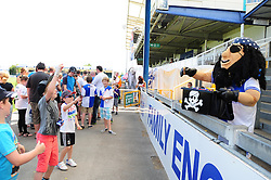 Bristol Rovers' mascot, Captain Black Arab hands out sweets to children at the fun day - Photo mandatory by-line: Dougie Allward/JMP - Tel: Mobile: 07966 386802 21/07/2013 - SPORT - FOOTBALL - Bristol -  Bristol Rovers Fun Day