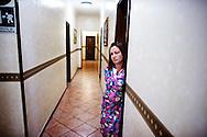 Napoli, Italia - 11 dicembre 2010. La signora Nunzia Fusco nel corridoio dell'hotel Vergilius nel quale vive da 8 anni dopo essere stata sfrattata..Ph. Roberto Salomone Ag. Controluce.ITALY - Nunzia Fusco in the corridor of Vergilius hotel in Naples on December 11, 2010.