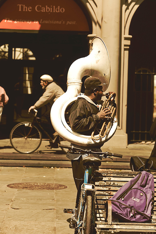 Street musician performs on Jackson Square in French Quarter of New Orleans, LA.  Copyright 2011 Reid McNally