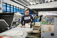 SOVERIA MANNELLI, ITALY - 17 NOVEMBER 2016: A man arranges sheets of paper here at the Rubbettino Publishing House in Soveria Mannelli, Italy, on November 17th 2016.<br /> <br /> Rubbettino Publishing House, founded by Rosario Rubbettino in 1973, is of the largest publishing and printing houses in Italy's South. To abate logistical costs and make sure of the production quality, Rubbettino Publishing House built an integrated cycle inside its large warehouse inside Soveria Mannelli. Over 80 employees edit, print and package 300 new books a year for the Italian market, generating a turnover of 8 million euros.<br /> <br /> Soveria Mannelli is a mountain-top village in the southern region of Calabria that counts 3,070 inhabitants. The town was a strategic outpost until the 1970s, when the main artery road from Naples area to Italy's south-western tip, Reggio Calabria went through the town. But once the government started building a motorway miles away, it was cut out from the fastest communications and from the most ambitious plans to develop Italy's South. Instead of despairing, residents benefited of the geographical disadvantage to keep away the mafia infiltrations, and started creating solid businesses thanks to its administrative stability, its forward-thinking mayors and a vibrant entrepreneurship numbering a national, medium-sized publishing house, a leading school furniture manufacturer and an ancient woolen mill.