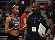 Mar 5, 2017; Albuquerque, NM, USA; Vashti Cunningham (left) with father and coach Randall Cunningham during the USA Indoor Championships at the Albuquerque Convention Center. Cunningham won at 6-5 (1.96m).