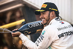 May 12, 2019 - Barcelona, Catalonia, Spain - LEWIS HAMILTON (GBR) from team Mercedes sprays champagne as he celebrates his victory of the Spanish GP on the podium at the Circuit de Barcelona - Catalunya (Credit Image: © Matthias OesterleZUMA Wire)
