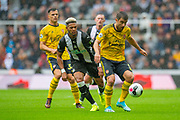 Sokratis (#5) of Arsenal FC shields the ball from Joelinton (#9) of Newcastle United FC during the Premier League match between Newcastle United and Arsenal at St. James's Park, Newcastle, England on 11 August 2019.