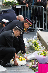 City Hall, London, June 5th 2017.  Emergency services chiefs lay flowers at a vigil held in remembrance of those killed during the June 3rd terror attack at London Bridge and Borough Market.