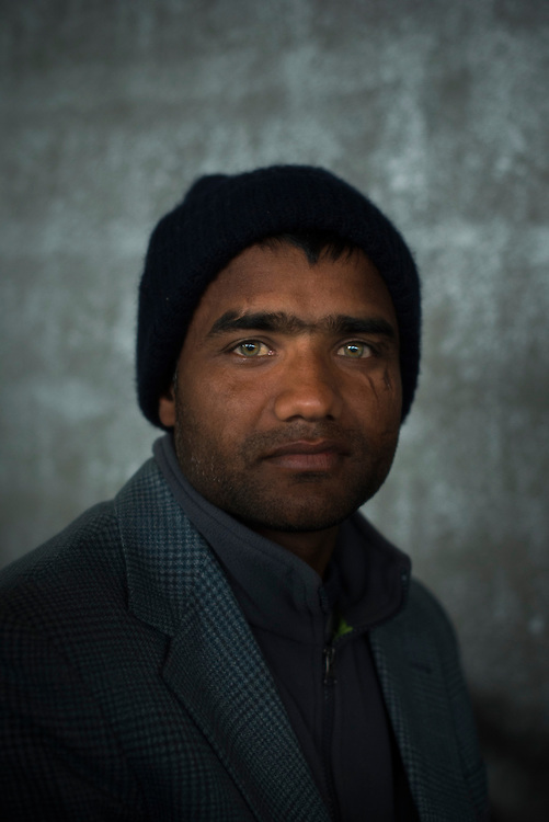 Manawar Iqbal, 28, from Lahore; Pakistan, poses for a portrait at a refugee camp on the Macedonian (FYROM) border on March 9, 2016 in Idomeni, Greece.