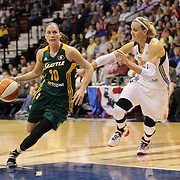 Sue Bird, Seattle Storm, dribbles past Katie Douglas, Connecticut Sun, during the Connecticut Sun Vs Seattle Storm WNBA regular season game at Mohegan Sun Arena, Uncasville, Connecticut, USA. 23rd May 2014. Photo Tim Clayton