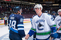PENTICTON, CANADA - SEPTEMBER 8: Kole Lind #78 of the Vancouver Canucks shake hands with the Winnipeg Jets on September 8, 2017 at the South Okanagan Event Centre in Penticton, British Columbia, Canada.  (Photo by Marissa Baecker/Shoot the Breeze)  *** Local Caption ***