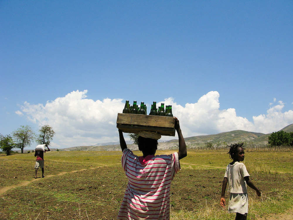 Children carry food and drinks on their heads.