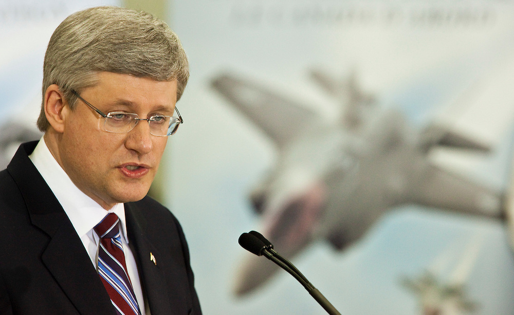 Prime Minister Stephen Harper speaks following a tour of  F-35 fighter jet contractor, Virtek Vision International in Waterloo Ontario, Friday, March 11, 2011.<br /> THE CANADIAN PRESS/ Geoff Robins