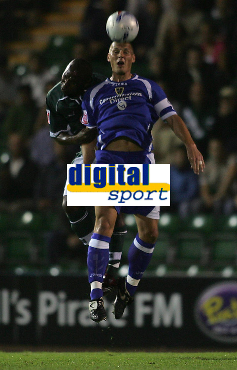 Photo: Lee Earle.<br /> Plymouth Argyle v Cardiff City. Coca Cola Championship. 12/09/2006. Cardiff's Darren Purse (F) beats Barry Hayles to the ball.