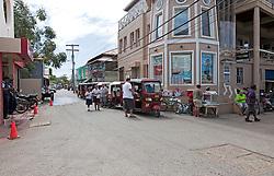 Mob scene on main street as the Tuk-tuks line up in wait for the La Ceiba ferry, Utila, Honduras.