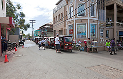 Mob scene on main street as the Tuk-tuks line up in wait for the La Ceiba ferry, Utila, Honduras.