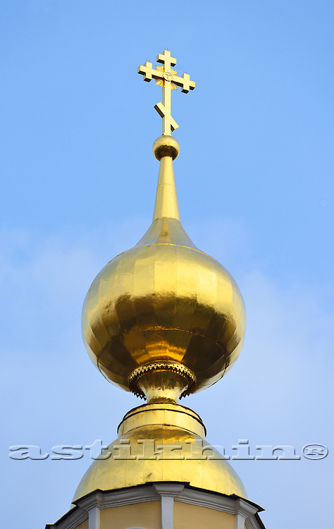 Orthodox Church's Cupola with Holy Crosse upon blue sky.