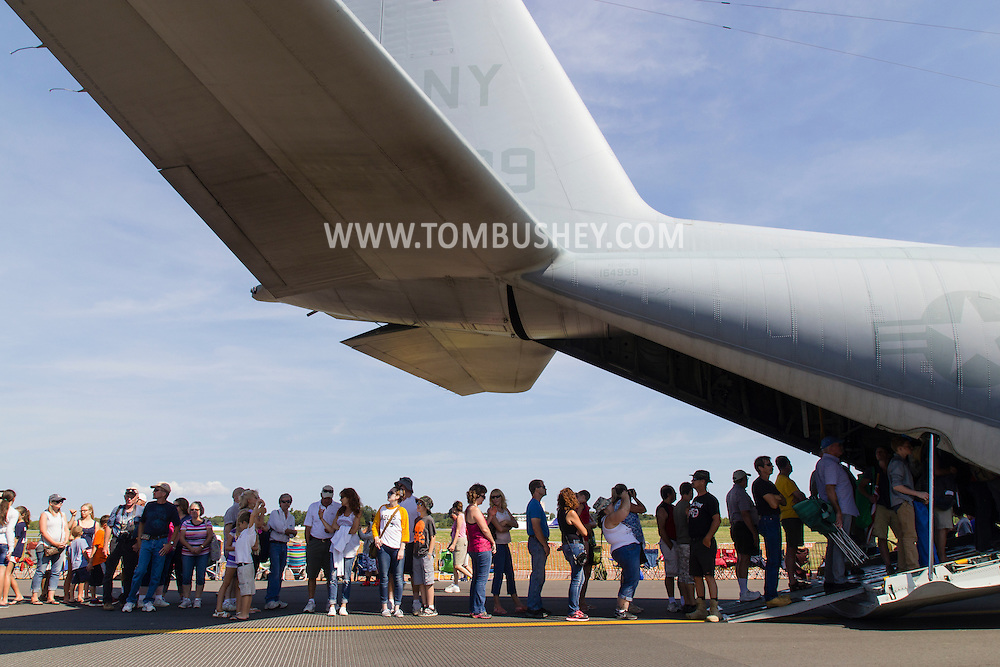 New Windsor, New York - People line up to take a tour inside a C-130J Hercules on display at the New York Air Show at Stewart International Airport on Aug. 30, 2015. ©Tom Bushey / The Image Works