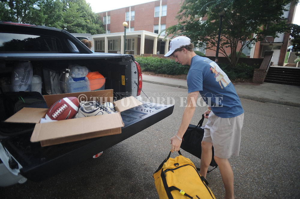 Ole Miss freshman student Nicholas Smith of Franklin, Tenn. moves into his dorm with help from his parents Bobette and Paul Smith in Oxford, Miss. on Thursday, August 19, 2010.