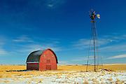 Red barn and windmill<br /> Vulcan<br /> Alberta<br /> Canada
