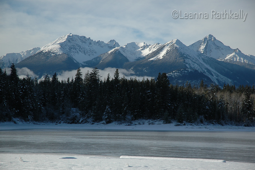 Snow patterns lead to the mountains near Bralorne, BC.