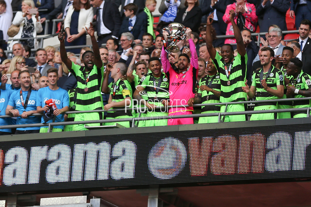 Forest Green Rovers goalkeeper Sam Russell(23) lifts the trophy during the Vanarama National League Play Off Final match between Tranmere Rovers and Forest Green Rovers at Wembley Stadium, London, England on 14 May 2017. Photo by Shane Healey.